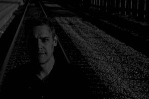 Ray Lugo photo portrait with train tacks behind Los Angeles California 2018